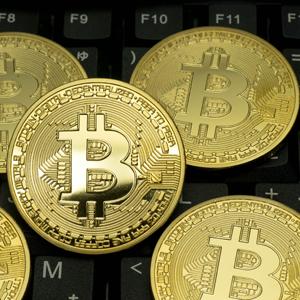 マネックスGなど仮想通貨関連株が高い、ビットコインは一時97万円台回復◇